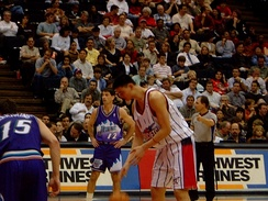 Yao prepares to shoot a free throw with John Stockton in the background