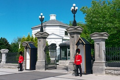The main gate of Rideau Hall flanked by sentry boxes