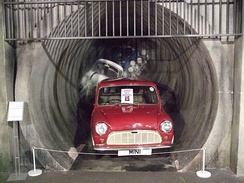A display of a Mini emerging from a sewer tunnel in Coventry Transport Museum
