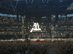 Adele at Wembley Stadium in June 2017. Adele's concert on 28 June was attended by 98,000 fans, a stadium record for a UK music event[148]