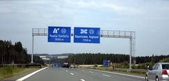 German road signs using both the DIN 1451 Mittelschrift (left) and Engschrift (right) typefaces