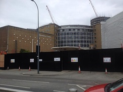Television Centre during redevelopment in May 2015. The BBC blocks on the wall of TC1 were removed in September 2014.