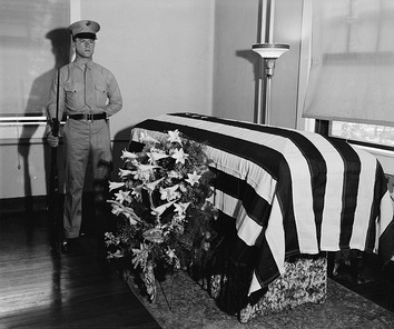 A Marine guards Swanson's body as it lies in state in Washington D.C.