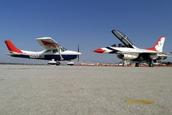 A Civil Air Patrol Cessna 182 posed with U.S. Air Force Thunderbirds Number 8 at March Air Reserve Base, March 2000