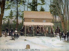 Hunting camp with dressed deer at Schoodic Lake, Maine, in 1905