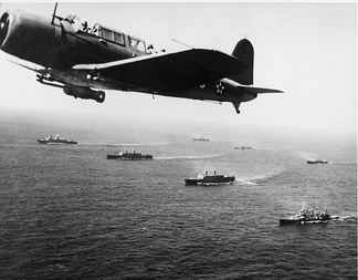 A convoy of merchant ships protected by airplanes en route to Cape Town during World War II