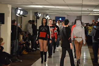 Male and female models on runway at a fashion show in Washington DC, February 2017
