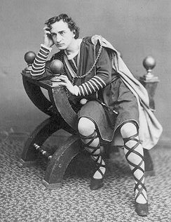 The American actor Edwin Booth as Hamlet, seated in a curule chair c. 1870. (Photographer unknown)