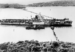 The British aircraft carrier HMS Formidable passing through the anti-submarine boom in Port Jackson (Sydney Harbour) in 1945