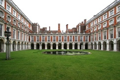 "The Fountain Court designed by Sir Christopher Wren (E on plan): ""Startling, as of simultaneous exposure to a great many eyes with raised eyebrows.""[29]"