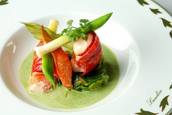 An example of nouvelle cuisine presentation. This dish consists of marinated crayfish on gazpacho asparagus and watercress.