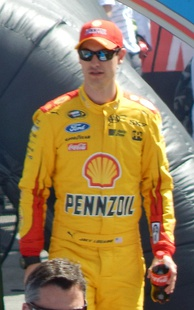 Joey Logano (pictured in 2015) took his first career victory and became the youngest driver to win a Sprint Cup Series race.