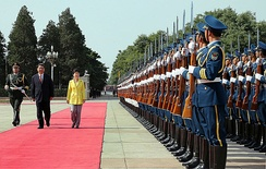 Chinese President Xi Jinping and a military honor guard welcomes South Korean president Park Geun-hye in June 2013.