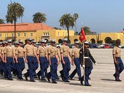 Marines marching during MCRD San Diego graduation ceremony.