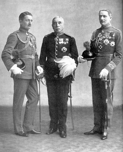 Geoffrey (pictured left) with his father and brother John