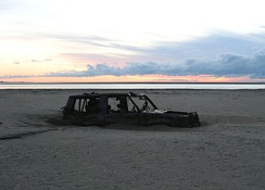 Abandoned car in Morecambe Bay, 400 metres (1,300 ft) from the shore