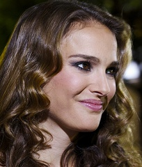 Natalie Portman looks to the camera's left, smiling