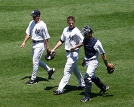 AJ Burnett (center) leaves the bullpen, flanked by pitching coach Dave Eiland and catcher Francisco Cervelli