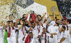 Qatar's players celebrating the country's first-ever Asian Cup title in the 2019.