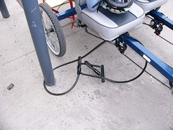 "A 4-wheel bike secured with a 15mm X 2.5 m cable and bike ""U"" lock to a steel signpost[13]"