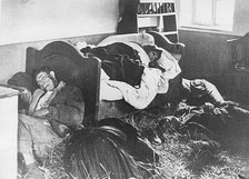 An entire Serb family lies slaughtered in their home following a raid by the Ustashe Militia, 1941.