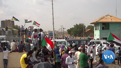 Sudanese protestors celebrate the 17 August 2019 signing of the Draft Constitutional Declaration between military and civilian representatives.