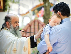 Christening photograph in Orthodox Church. The moment of Catechism.
