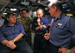 The UK First Sea Lord, Admiral Stanhope (left), and US Chief of Naval Operations, Admiral Jonathan Greenert (centre), are briefed by the CO (right) on the capabilities of Astute during the joint exercise Fellowship 2012 between Astute and New Mexico