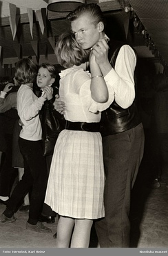 Young couples at a school dance in 1950s Sweden.
