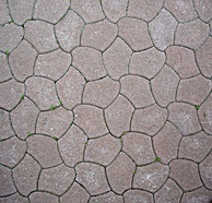 This tessellated, monohedral street pavement uses curved shapes instead of polygons. It belongs to wallpaper group p3.