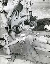Patton talks to wounded soldiers preparing for evacuation