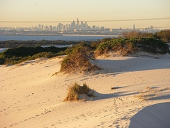Kurnell Sand Dunes with the Sydney skyline in background.