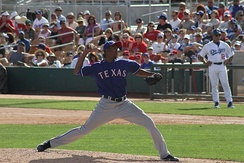 Ogando pitching for the Texas Rangers during spring training in 2011