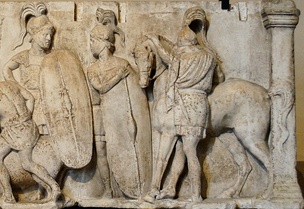Altar of Domitius Ahenobarbus, c. 122 BC; the altar shows two Roman infantrymen equipped with long scuta and a cavalryman with his horse. All are shown wearing chain mail armour.