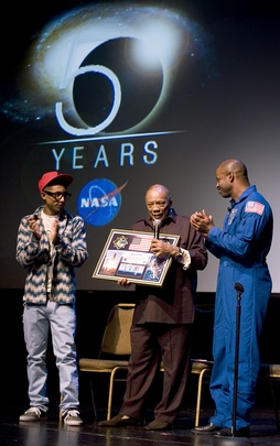 Pharrell Williams and American astronaut Leland D. Melvin present a NASA montage to Jones.