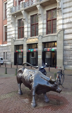 Entrance of the stock exchange building and bull.