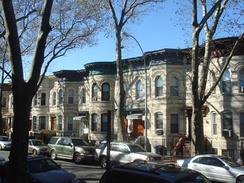 Brick row houses on Weirfield Street, a style that spreads into Ridgewood, Queens