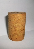 A Champagne cork before usage. Only the lower section, made of top-quality pristine cork, will be in contact with the Champagne