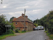 The approach to the village from Erpingham where the lane crosses Scarrow Beck.
