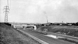 Looking north from a similar position south of Toddington services in July 1959, nearing completion