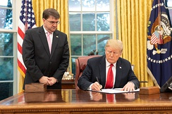 Wilkie watches as President Donald Trump signs The Veterans Treatment Court Improvement Act of 2018.