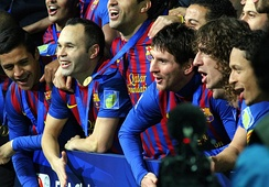 Iniesta (second from left) and his teammates celebrate winning the 2011 FIFA Club World Cup.