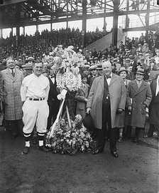 On behalf of the Elks of Washington, Joe Judge (front left), captain of the Senators, was presented with a floral tribute for the team before the start of a game in 1929