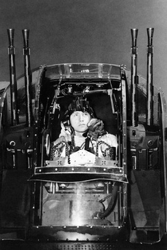 Flight sergeant J Morgan, the rear gunner of an Avro Lancaster of No. 630 Squadron at RAF East Kirkby, checks his guns before taking off on a night raid on the marshalling yards at Juvisy-sur-Orge, France