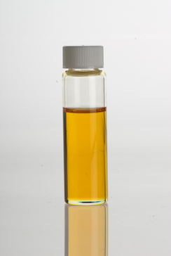 Lemon Myrtle (Backhousia citriodora) essential oil in a clear glass vial