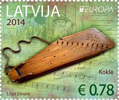 A postmark issued by the Latvian Post in 2014 featuring Latgale kokles