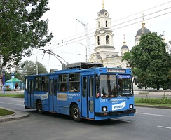 A Donetsk trolley bus with the Cathedral of Transfiguration of Jesus in the background.