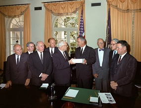 The Warren Commission presents its report to President Johnson. From left to right: John McCloy, J. Lee Rankin (General Counsel), Senator Richard Russell, Congressman Gerald Ford, Chief Justice Earl Warren, President Lyndon B. Johnson, Allen Dulles, Senator John Sherman Cooper, and Congressman Hale Boggs.