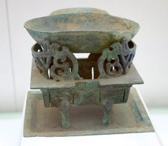 A bowl and stove used for the preparation of alcohol during the early Han dynasty.
