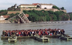 People crossing the Danube after the destruction of three bridges in Novi Sad